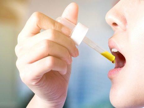 CBD oil on tongue